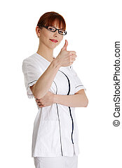 Young female doctor gesturing ok