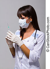young female doctor holding a syringe in her hand