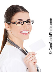 Young female doctor holding business card.