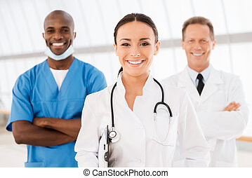 Young female doctor leading her team. Beautiful female...