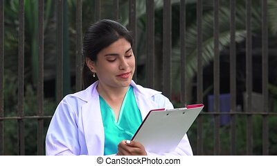Young Female Doctor Or Nurse Writing
