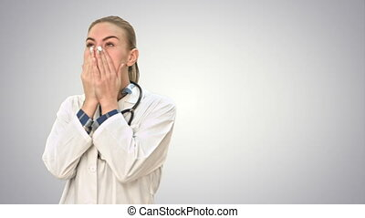 Young female doctor tired, yawning and suffering from headache on white background.