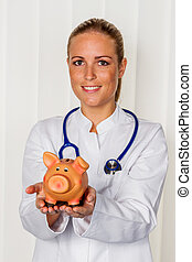 young female doctor with piggy bank