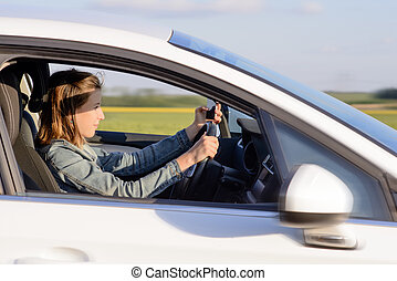 Young Female Driver Driving a Car on the Road