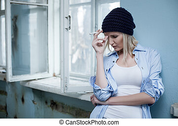 Young female drug addict wants new dose - Sad blond woman is...