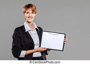 Young female employee holding a clipboard