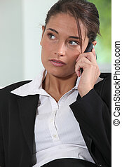 Young female executive using a mobile phone