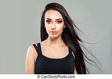 Young Female Face. Perfect Woman Fashion Model with Long Healthy Hair