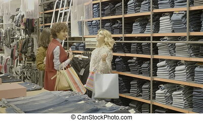Young female friends looking for boyfriends gifts for valentines day at the mall while holding shopping bags in their hands
