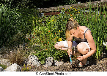 Young female gardening - Female while planting something in ...