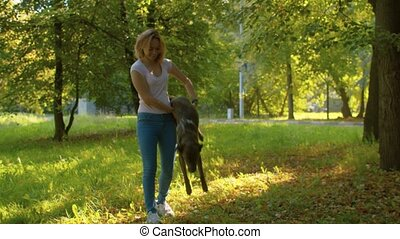 Young female handler training a dog