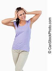 Young female having migraine