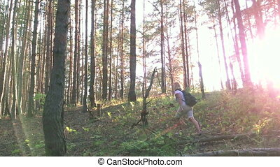 Young female hiker in forest. slow motion
