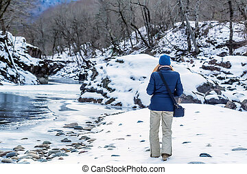Young female hiker in winter