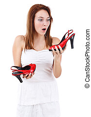 Young female holding her new shoe