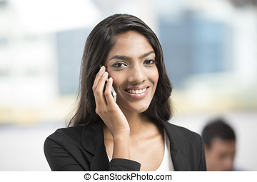Indian office executive using a smart phone - Young female...