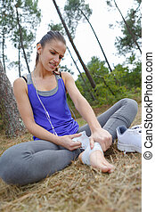 young female jogger having pain in her leg at park