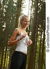 young female jogger with a water bottle