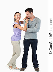 Young female leaning on her boyfriend's shoulder