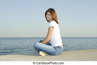 Young female looking to the ocean