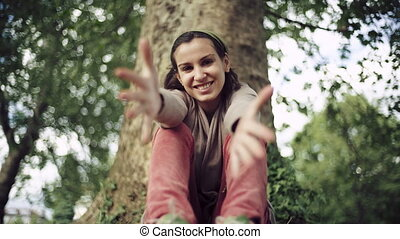 Young female makes a heart with hands smiling
