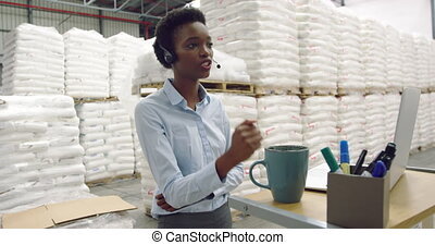 Young female male manager in a warehouse