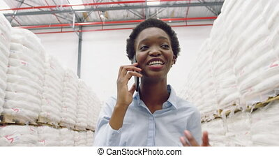 Young female manager in a warehouse