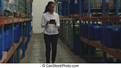 Young female manager worker in a warehouse