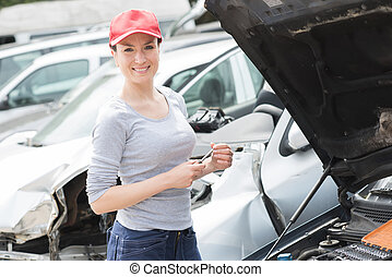 young female mechanic at work