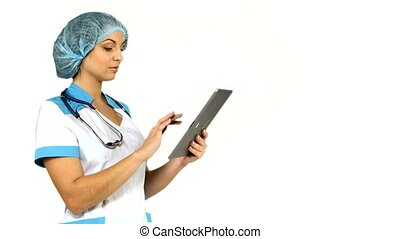 young female medical nurse using tablet computer on white background.