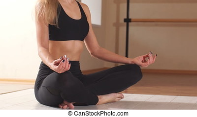 Young Female Meditate in Her Living Room. - Young Female...