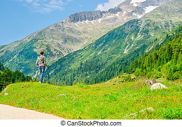 Young female mountaineer with alpine landscape