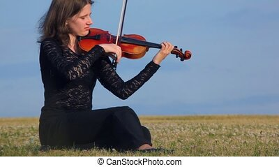 musician plays violin - young female musician plays violin...