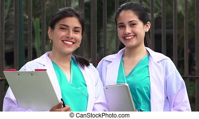 Young Female Nurses Smiling