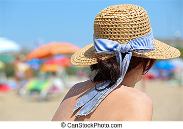 young female on summer with hat