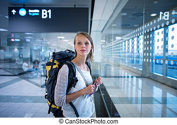 Young female passenger at the airport