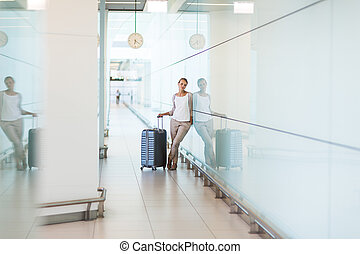 Young female passenger at the airport,