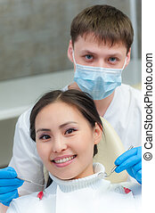 Young female patient at dentist office