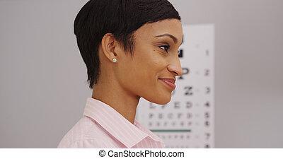 Young female patient wearing prescription eyeglasses