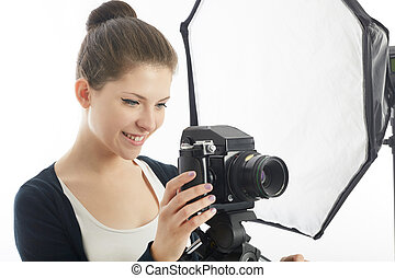 young female photographer working in studio
