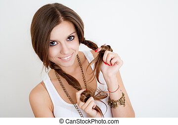 young female playing with her braids