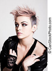 Young Female Punk with Pink Hair - An attractive young woman...
