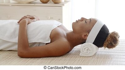 Young Female Relaxing In Spa Salon