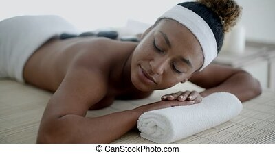 Young Female Relaxing In Spa Salon - African american woman...