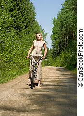 young female riding a bike in nature