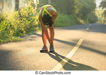Young female runner got sports injury on knee