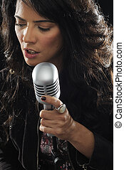Young female singer with retro mic