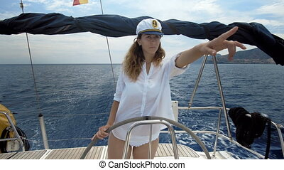 Young female skipper enjoying on the yacht