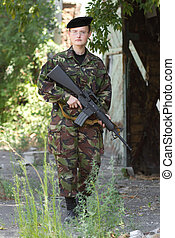 Young female soldier on guard