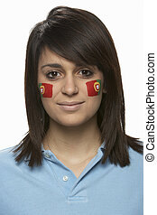 Young Female Sports Fan With Portugese Flag Painted On Face